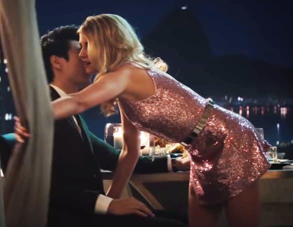 Kristen Stewart in a pink sequin dress and blond wig