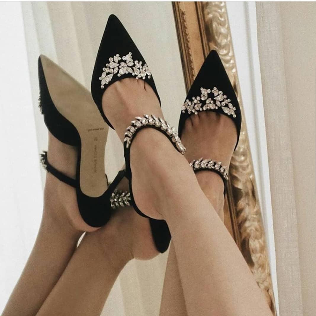 Black Pointer Toe Slip-Ons with Rhinestones.