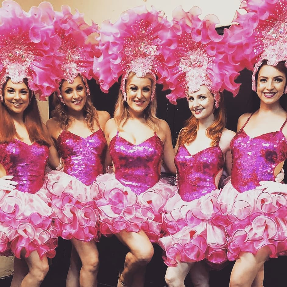 Showgirls Pink Sequin Short Dress with Ruffle Hemline and Organza Headdress.