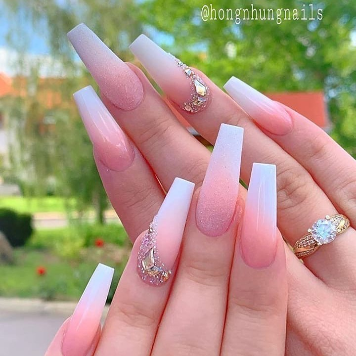 Light Pink and Pearl White Glittering Nail Polish with Rhinestones Design