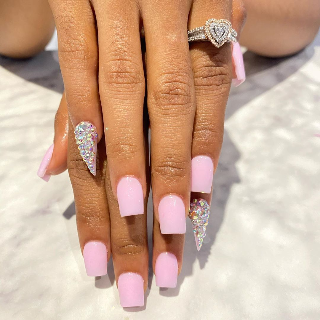 Light Pink Glittering Nail Polish with Rhinestones On The Pinky Finger