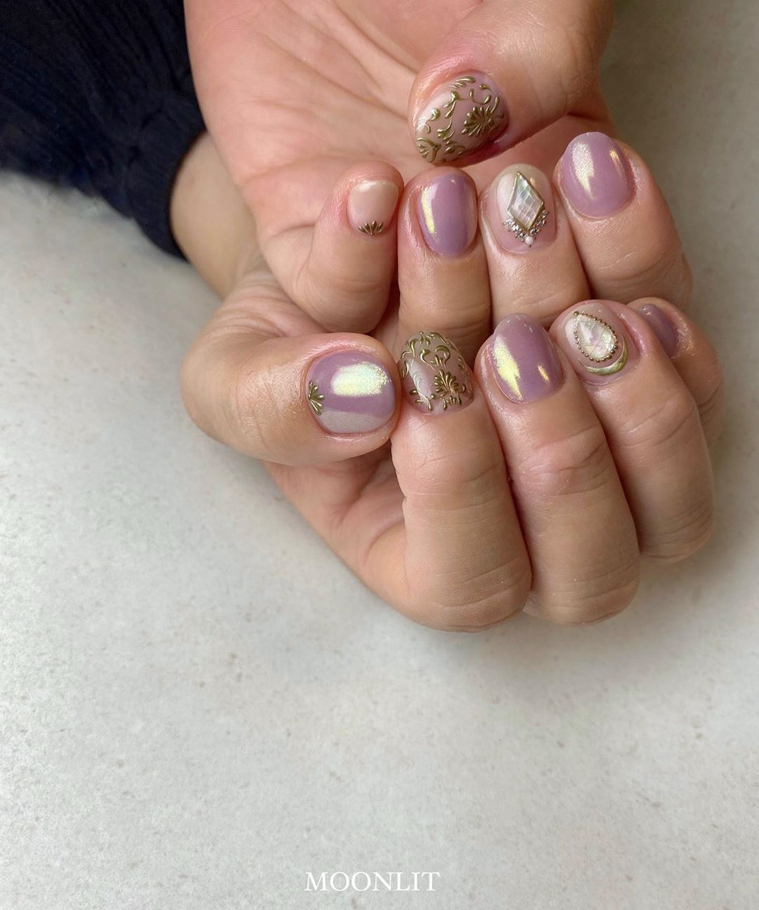 Light Glittering Pink Nail Polish with Silver and Clear Rhinestones