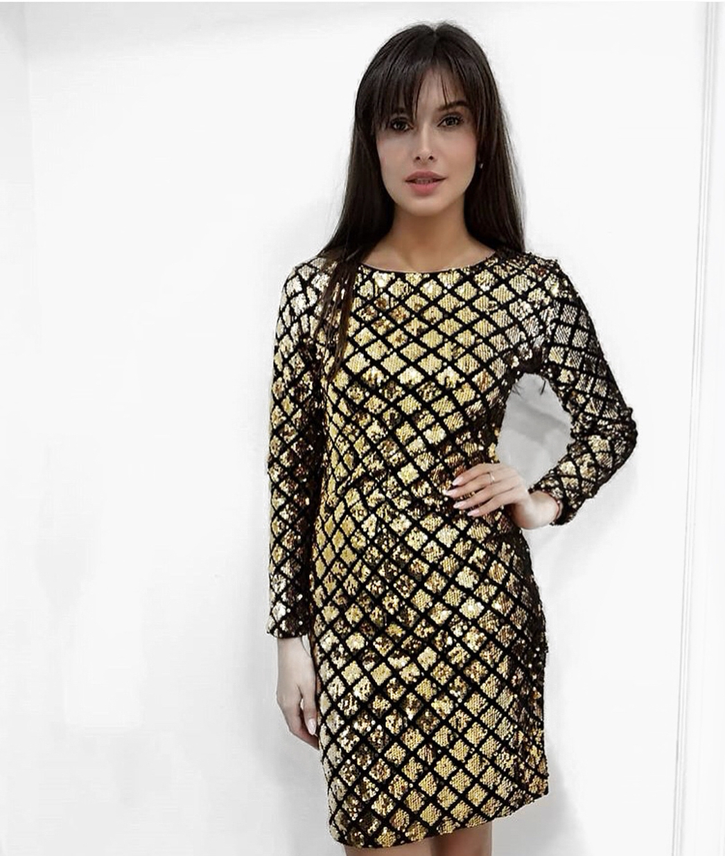 Black Short Dress With Gold Sequins And Full Sleeves.