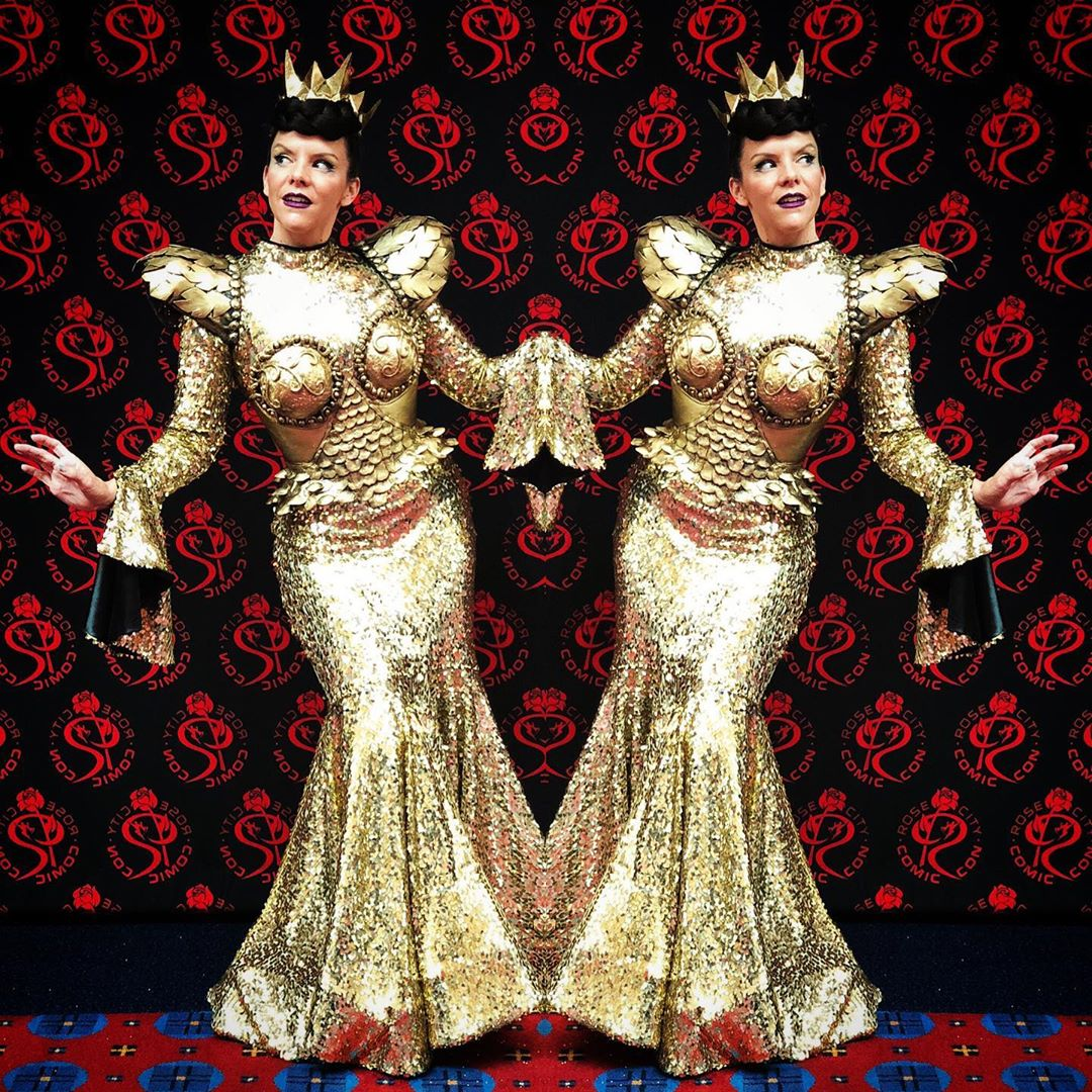 Long Sleeve Gold Sequin Costume with Mermaid Hemline and Shoulder Pads.