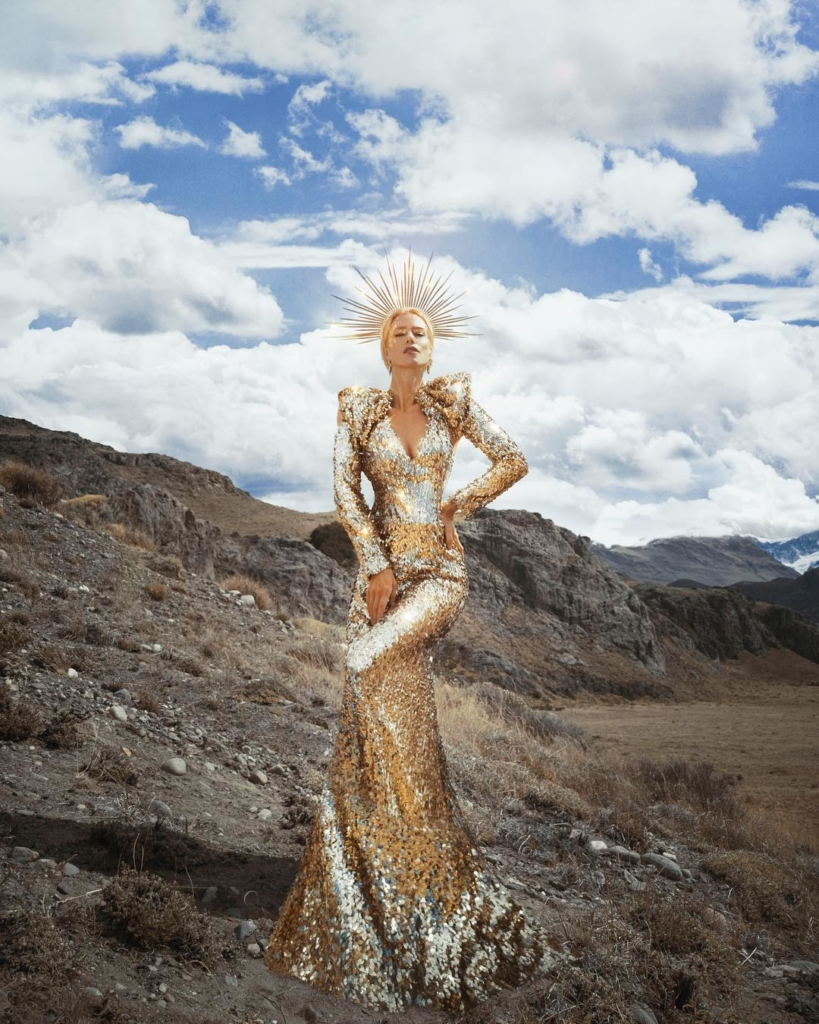 Long Gold Sequin Gown with Long Sleeves and Padded Shoulders.