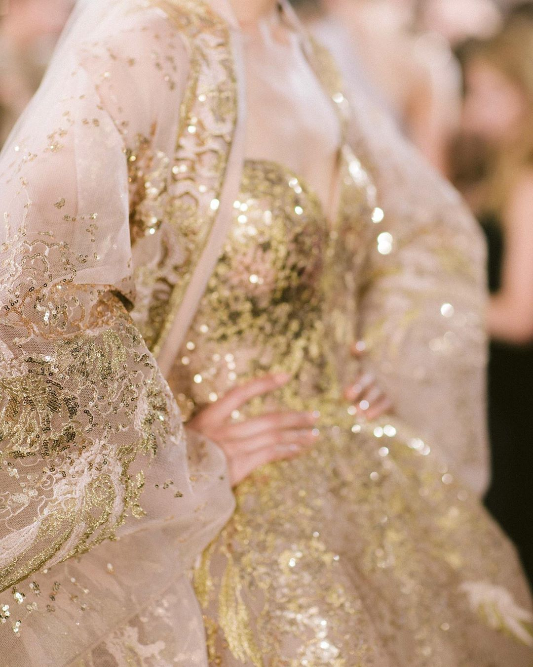 Sweetheart Neckline Gold Sequin Gown with Embroidered Net Shawl.