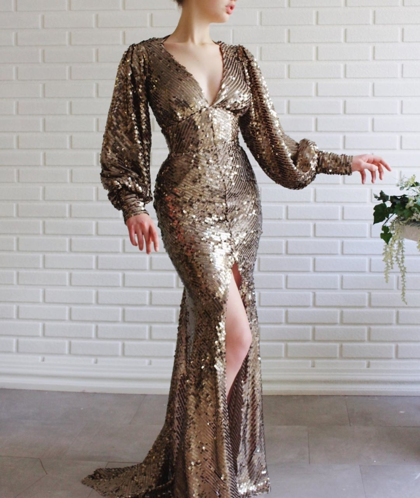 Gold Sequin Deep V-Neck Long Sleeves Gown with A Slit.