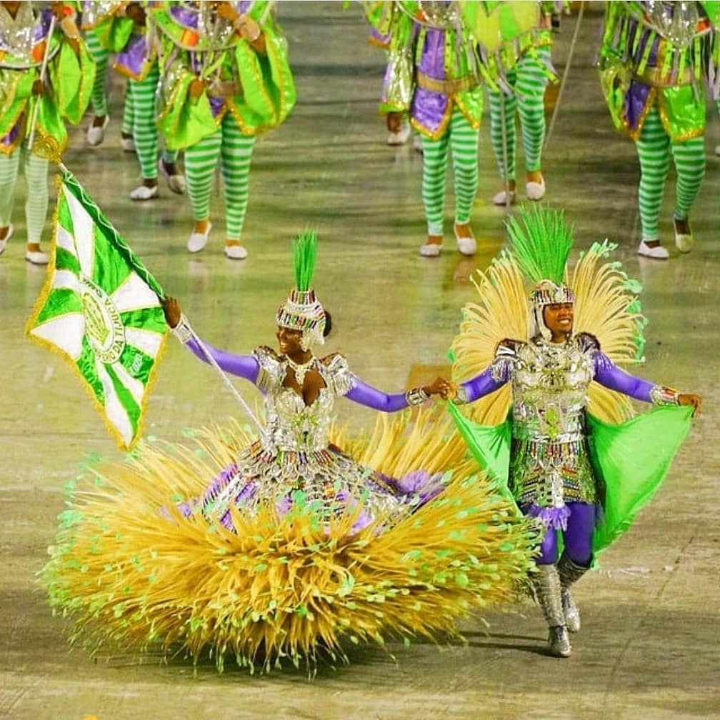Purple, Green and Yellow Carnival Costumes with Full Sleeves.
