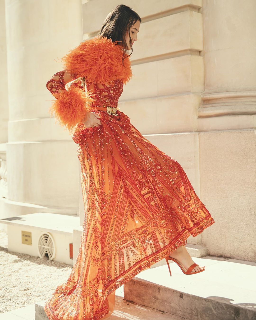 Colorful Orange Sequin Dress with Long Sleeves, Sequins and Feather Trim.