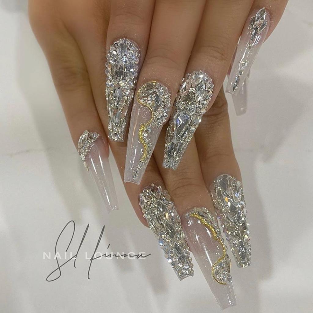 Pearl White Glittering Nail Polish with Silver Rhinestones Nail Art