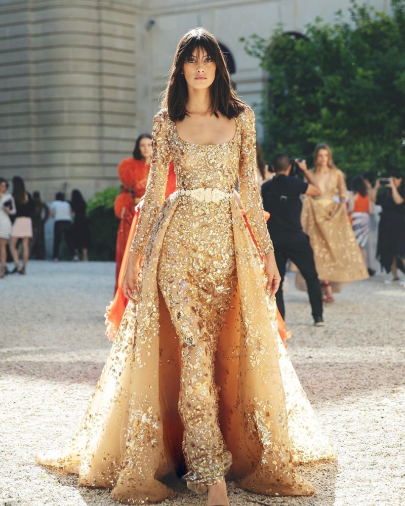 Sequin Evening Gown with Sleeves, Scoop Neck and Voluminous Skirt in Gold.