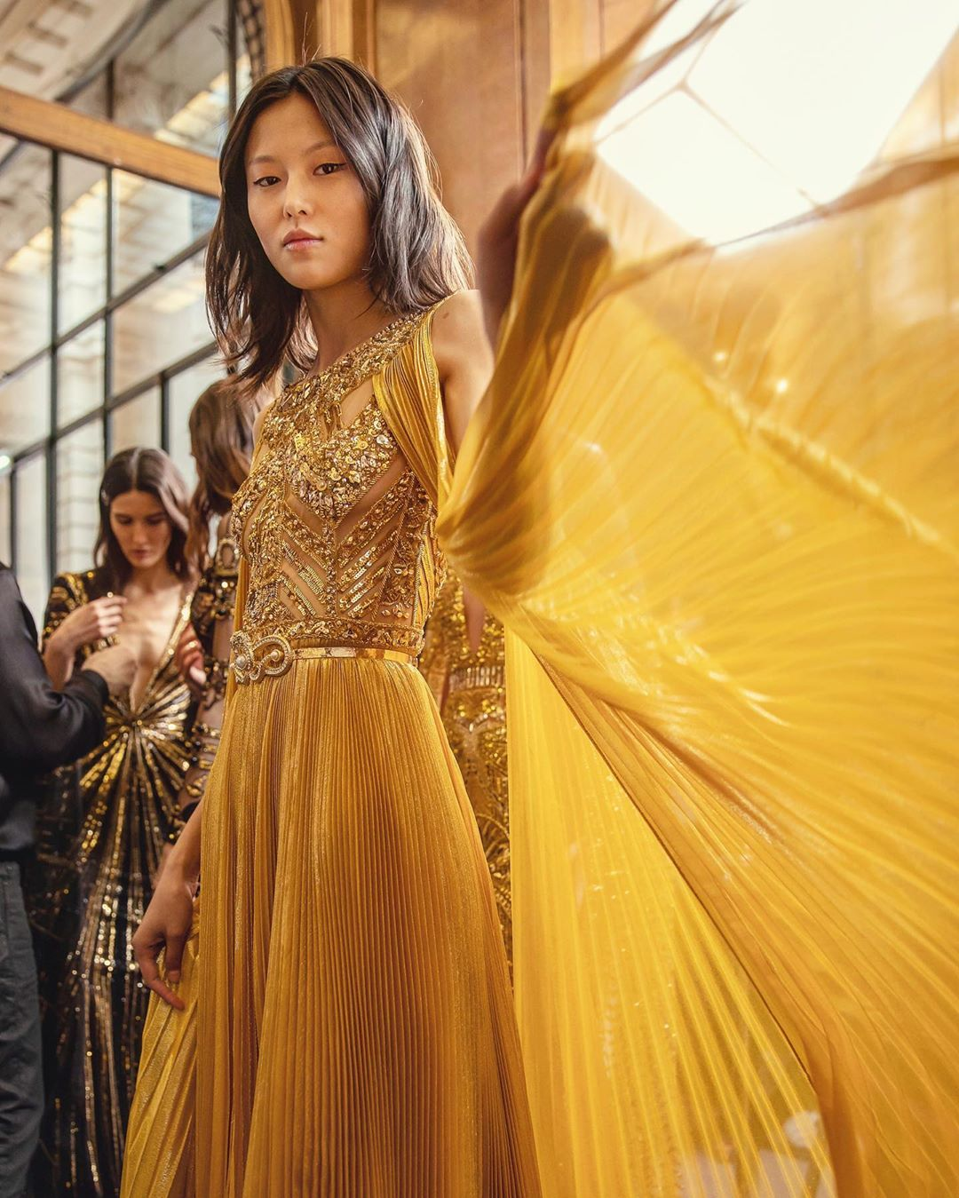 Gold Sleeveless Sequin Long Gown with Intricate Bodice and Pleated Organza.