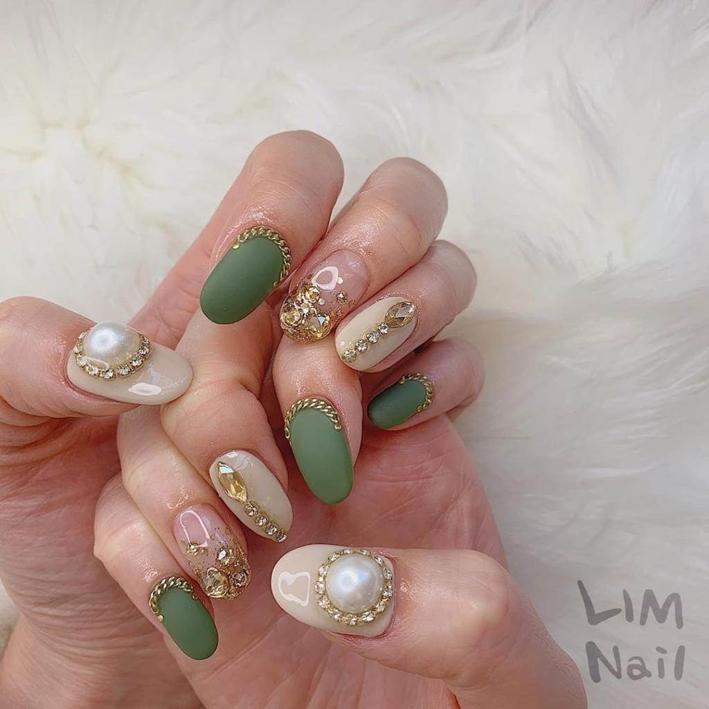 Dark Green Nail Polish with Rhinestones, Pearls and Gold Chain Nail Art