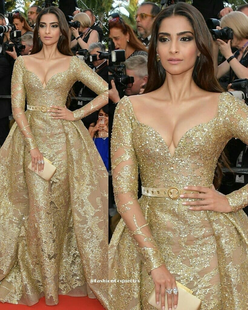 Gold Sequin Gown with Sweetheart Neck, Long Sleeves and Full Skirt.