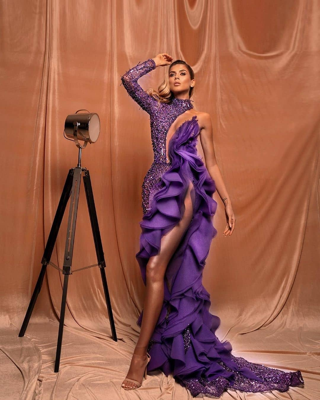 Cascading Purple One Shoulder Long Gown with Ruffles.