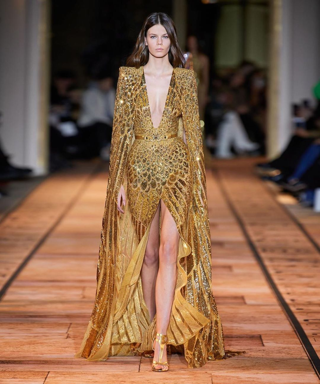 Long Sequin Gown with Deep V-Neck and Cape.