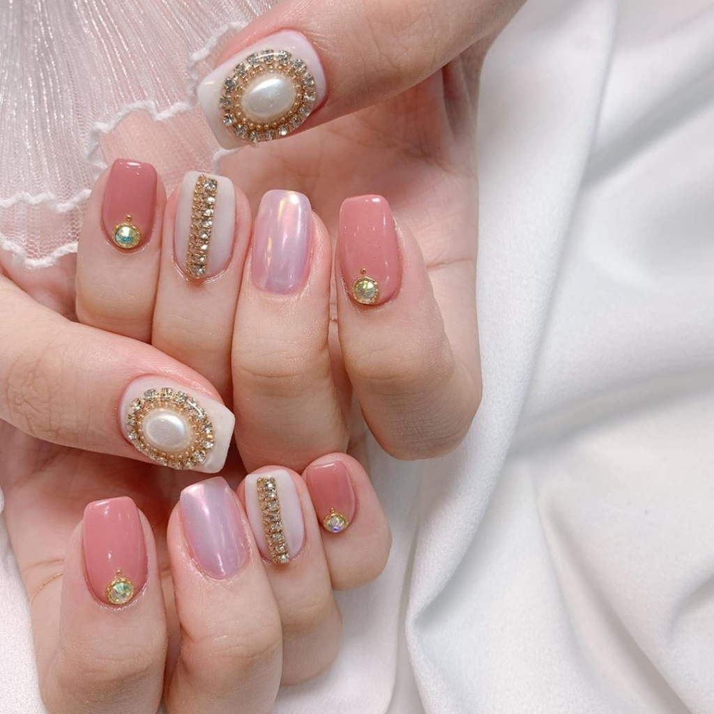 Dark and Light Pink Nail Polish with White Pearls and Rhinestones