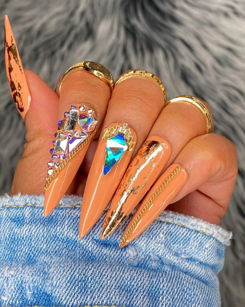 Brown Nail Polish with Sequins and Blue/Clear Rhinestones Nail Art.