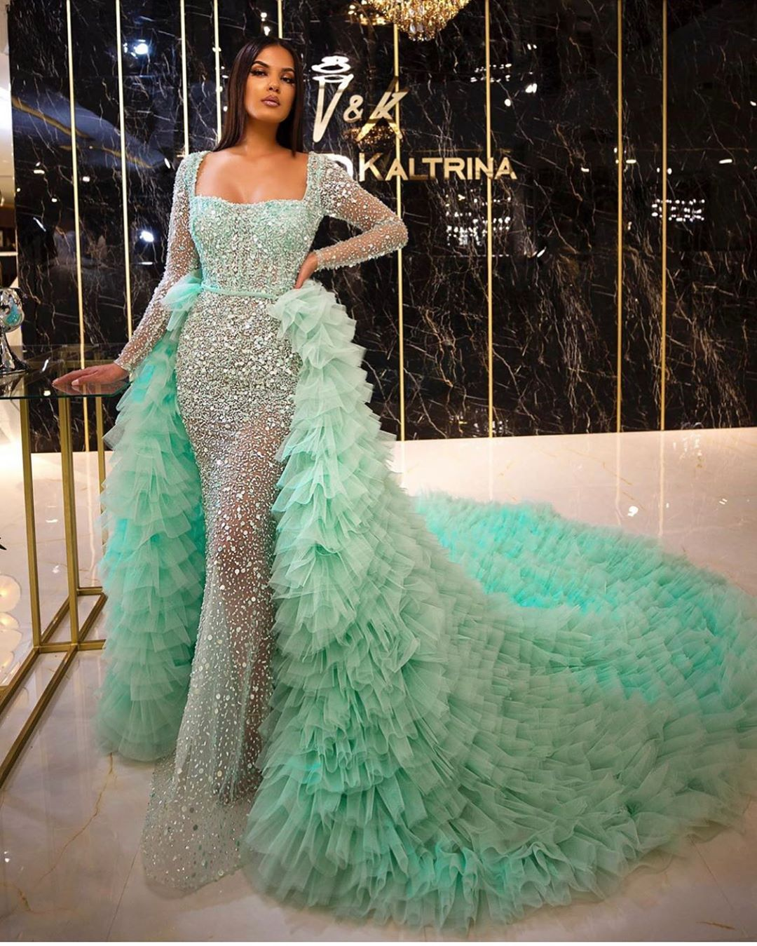 Pastel Green Sequin Gown with Ruffle Train.