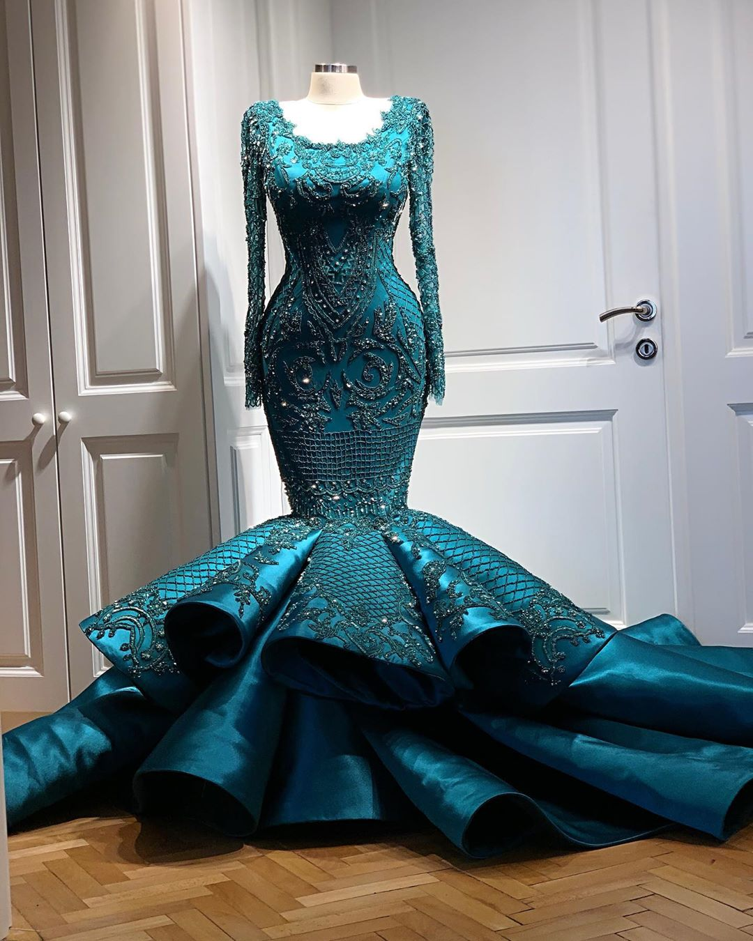 Green Haute Couture Handmade Gown With Full Sleeves.