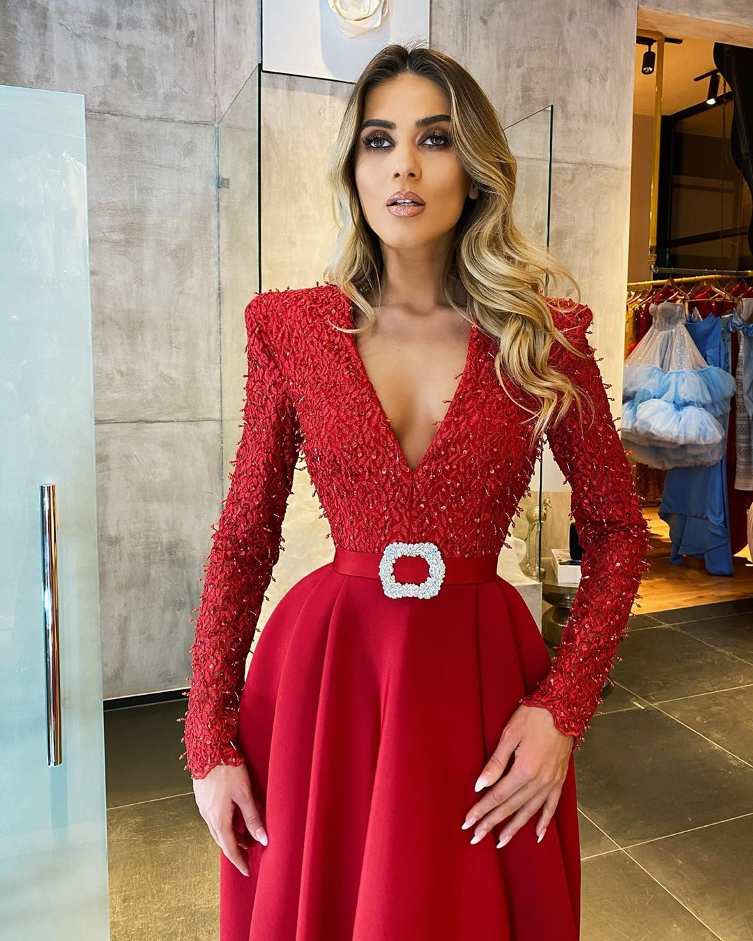 Red On Red Long Sequin and Bead Gown with Deep V-Neck And Full Sleeves.