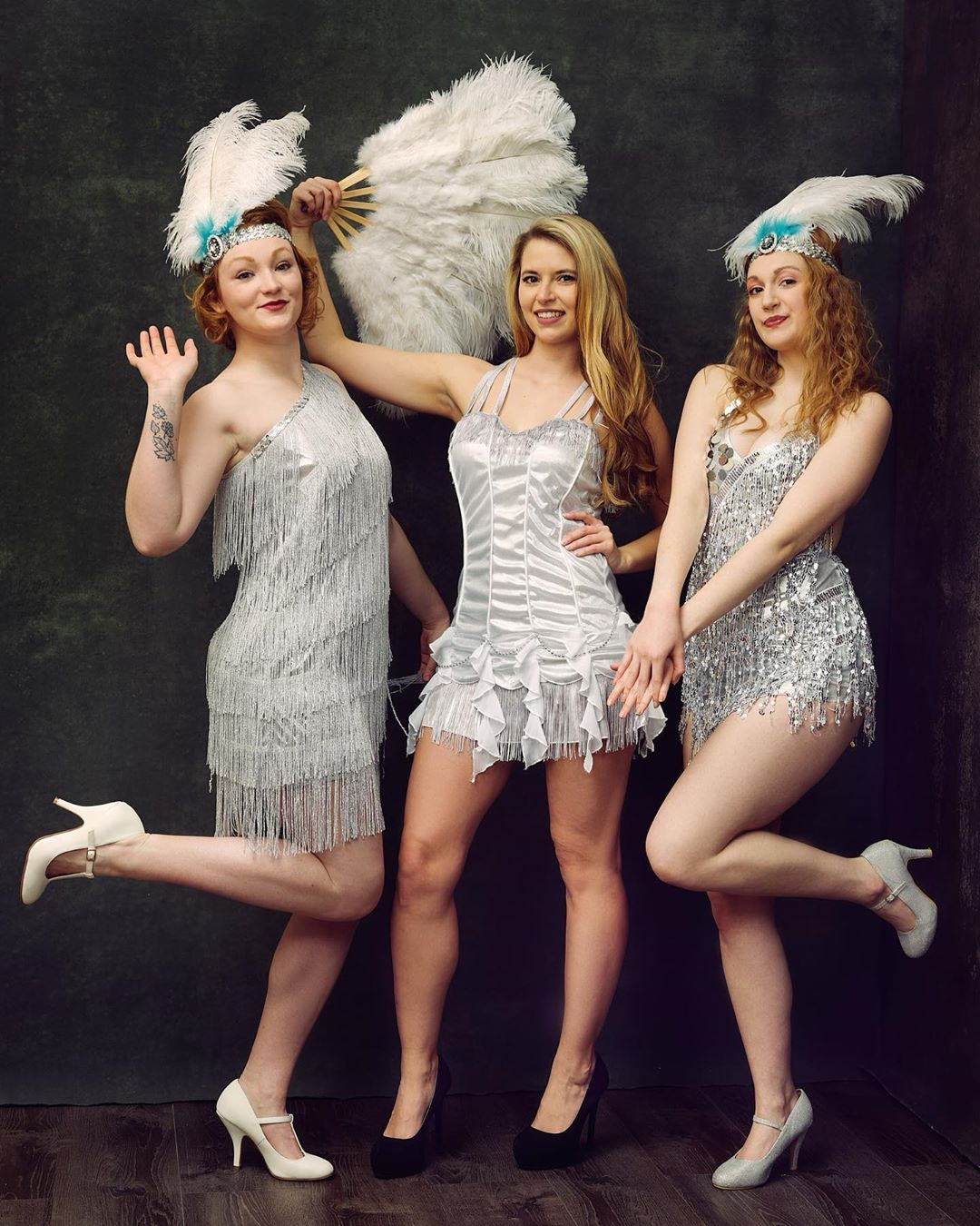 Silver Sequin Stage Dresses with Hanging Beaded Hemline.