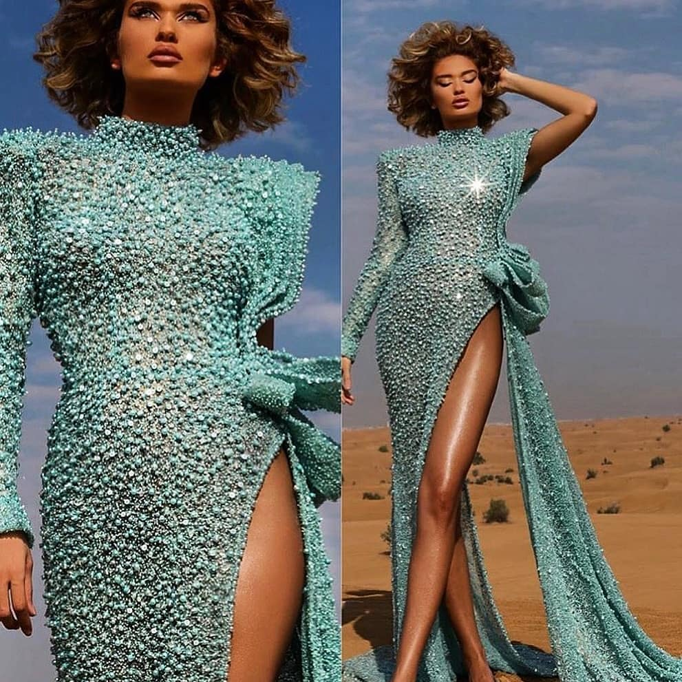 Turquoise Couture Crystal and Beaded Gown with High Slit, Rouched Bow and Single Sleeve. The best bling online.