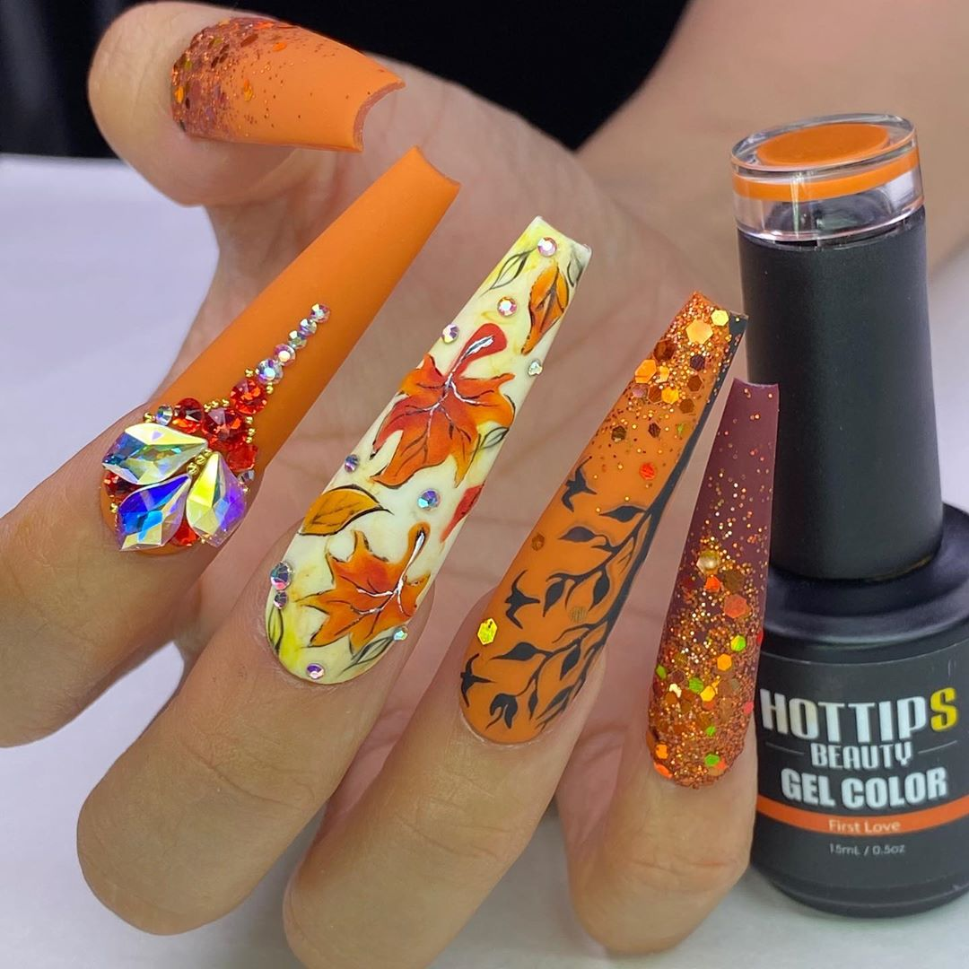 Orange Nail Color with Rhinestones and Glitters.