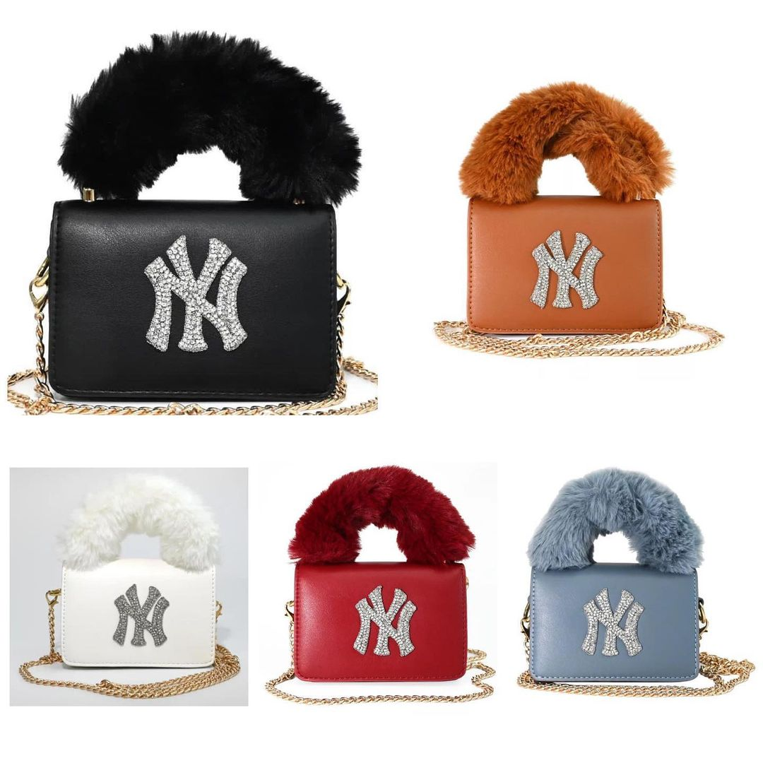 Small Handbag with Rhinestones and Fur Hand Strap