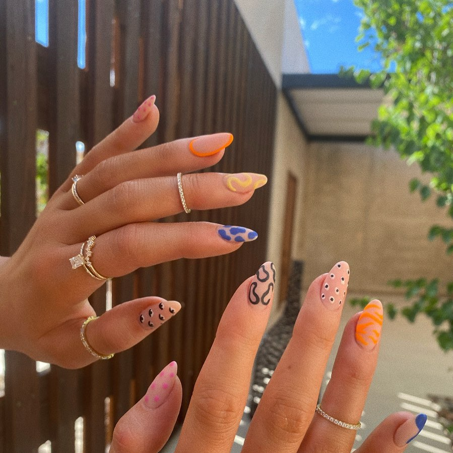 Kylie Jenner Loves Her Nails Painted and Rings