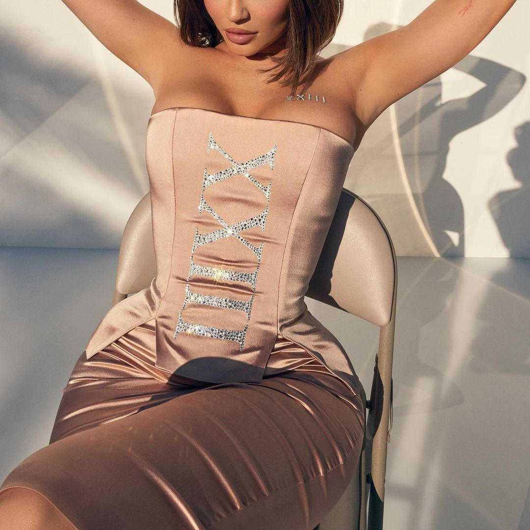 Kylie Jenner In an Off The Shoulder Short Dress Being Kissed By The Sun