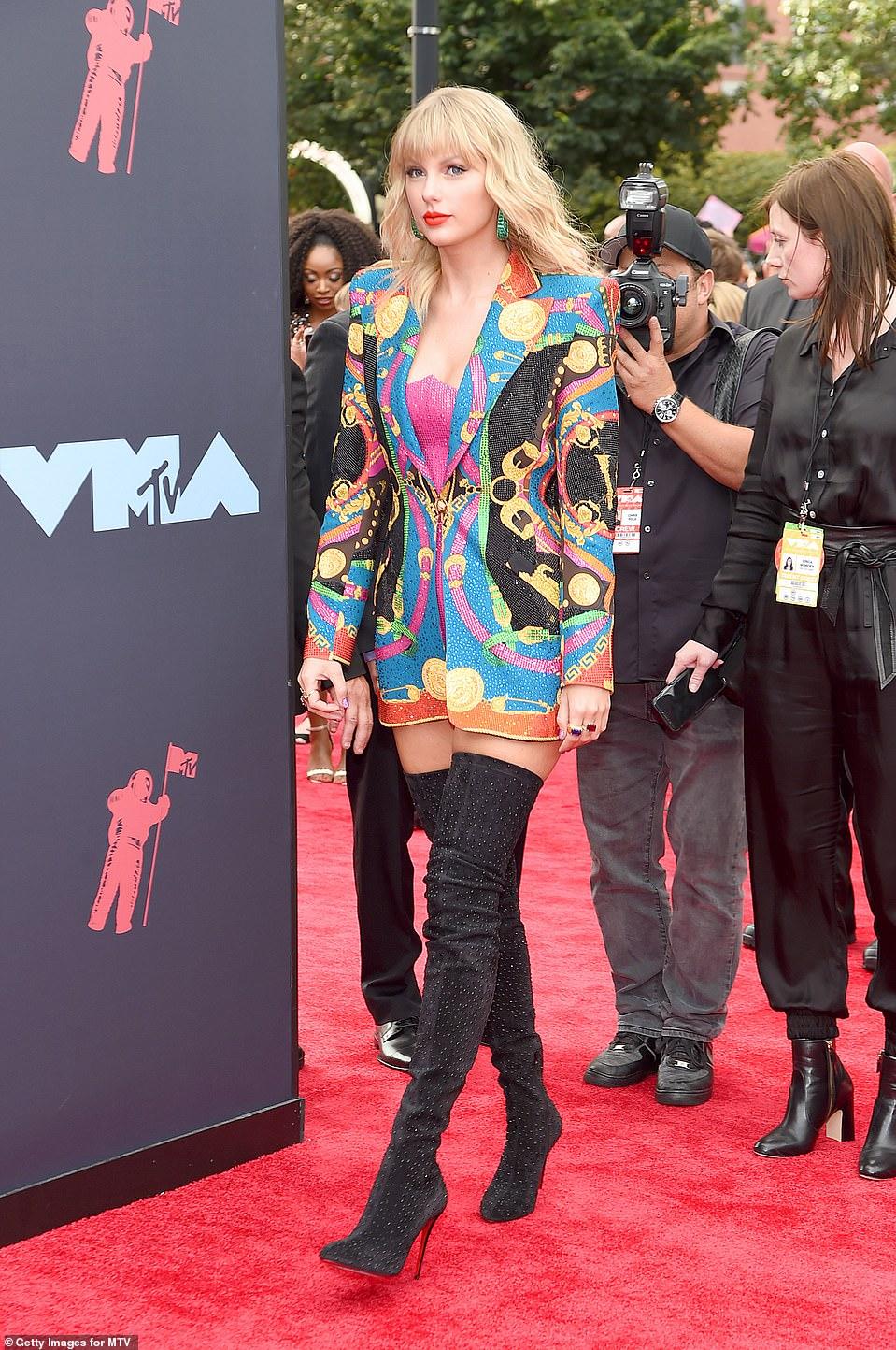 Red Carpet bling Taylor Swift Wears a Multi-Colour Sequin Blazer Dress