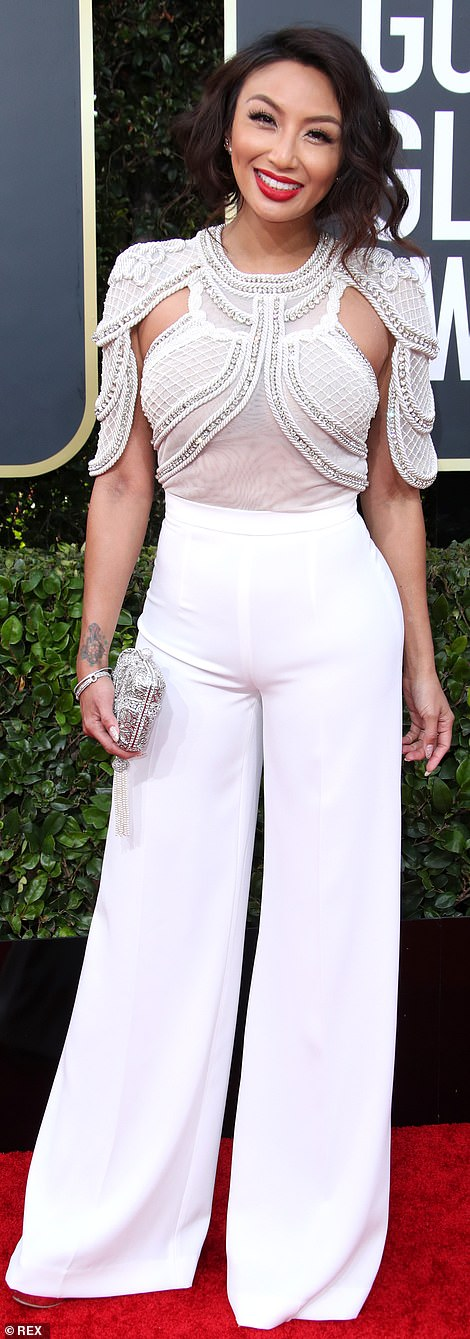 Red Carpet bling Jennie Mai In An Embellished White Top With Long Pant