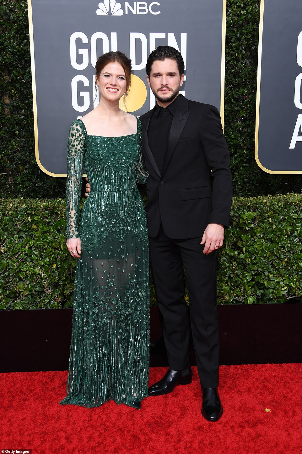 Red Carpet bling Kit Harington was Joined by His Wife Rose Leslie Wearing a Green Long Sleeves Gown with Crystals and Beads