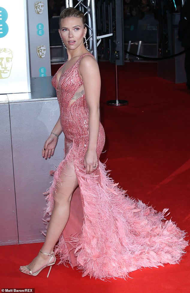 Red Carpet bling Nominee Scarlett Wears a Dazzling Pink Gown with a Low-Cut Neckline, A Beaded Bodice And A Tasseled Hemline