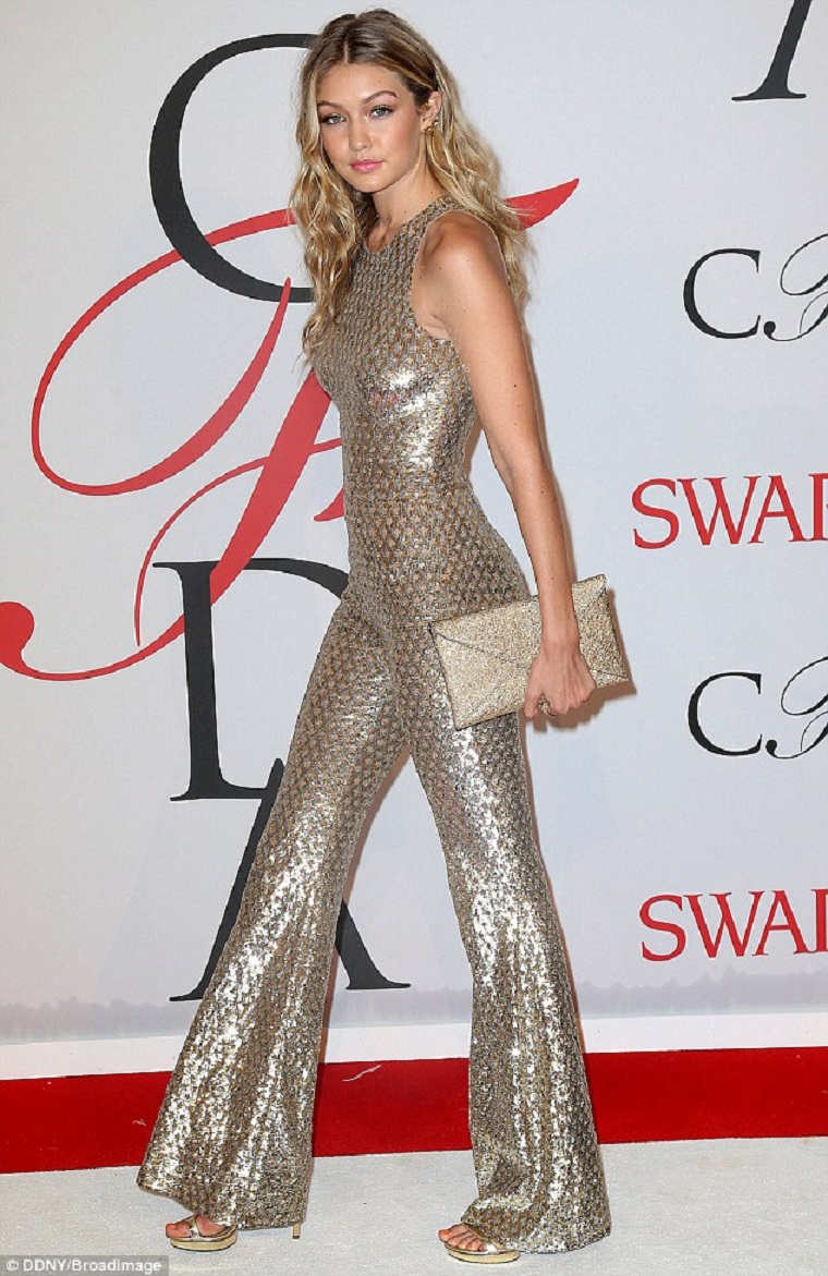 Celebrities Wearing Bling Gigi Hadid Shines Perfectly In A Gold Sequin Sleeveless Jumpsuit