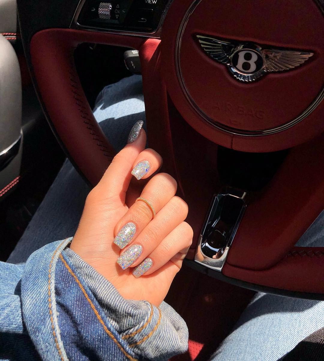 Kylie Jenner In Her Bentley with Her Nails Bling