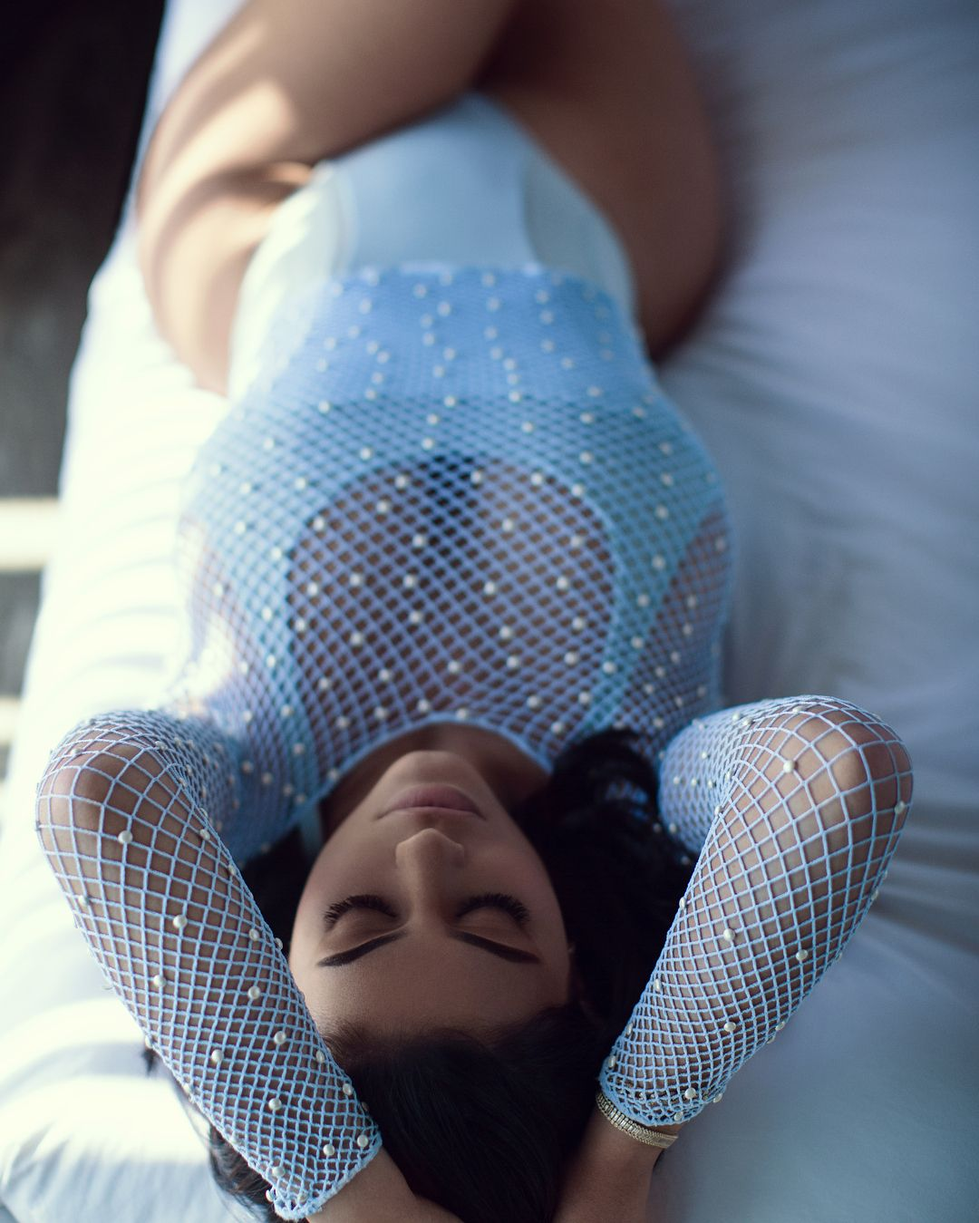 Kylie Jenner In Her Fish Net Swim Suit with Pears