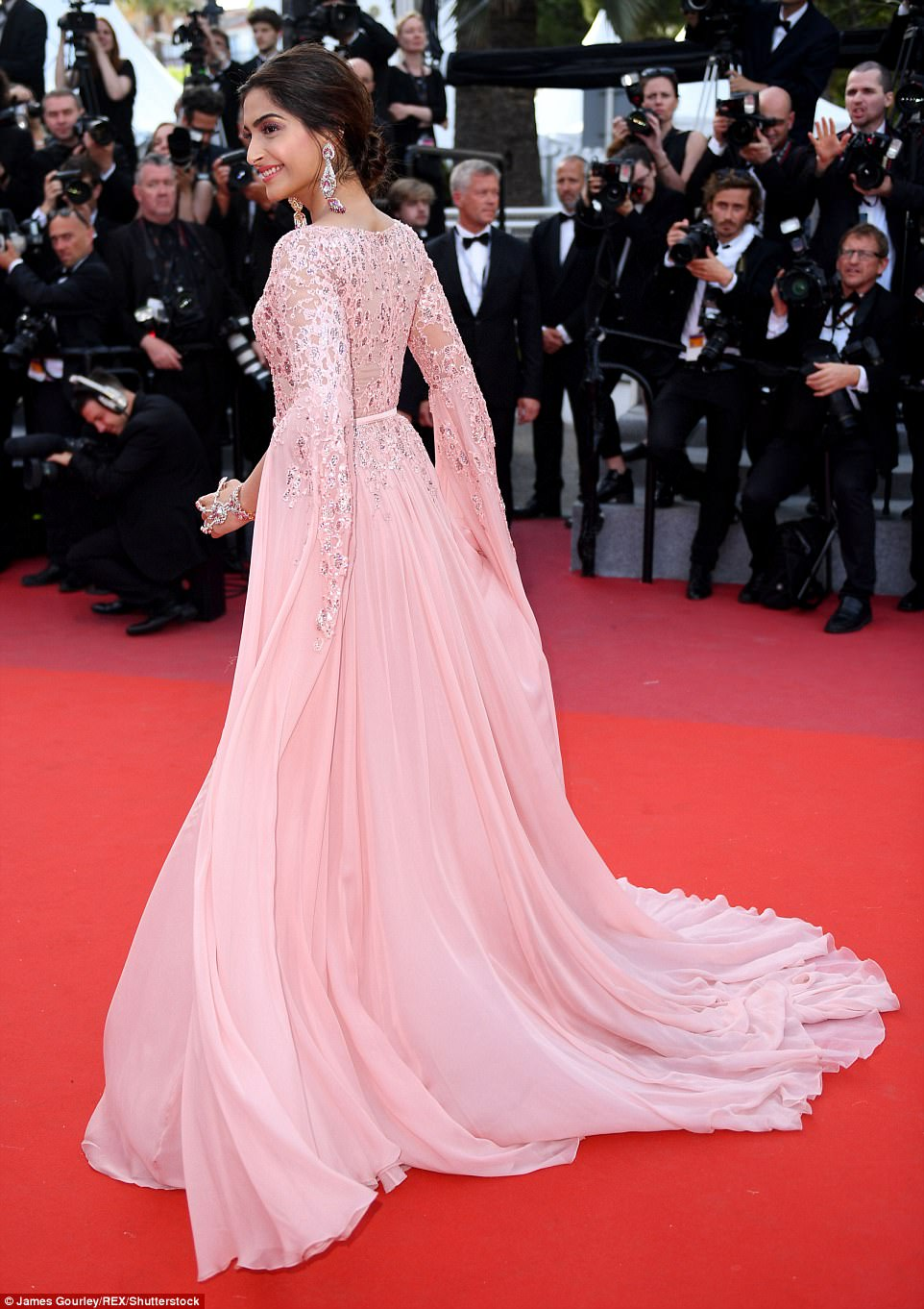 Red Carpet bling Sonam Kapoor Wears a Long Oversize Sleeves Long Gown with Sequins and Rhinestones