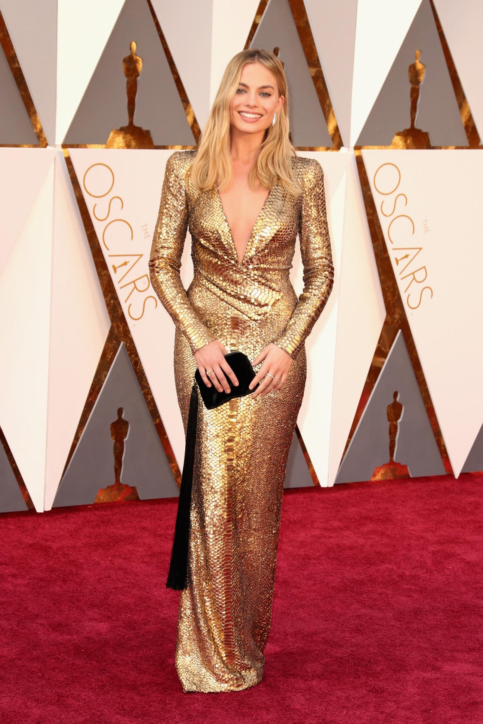 Margot Robbie Wear A Long Sleeves Deep Cut V-Neck Gold Gown