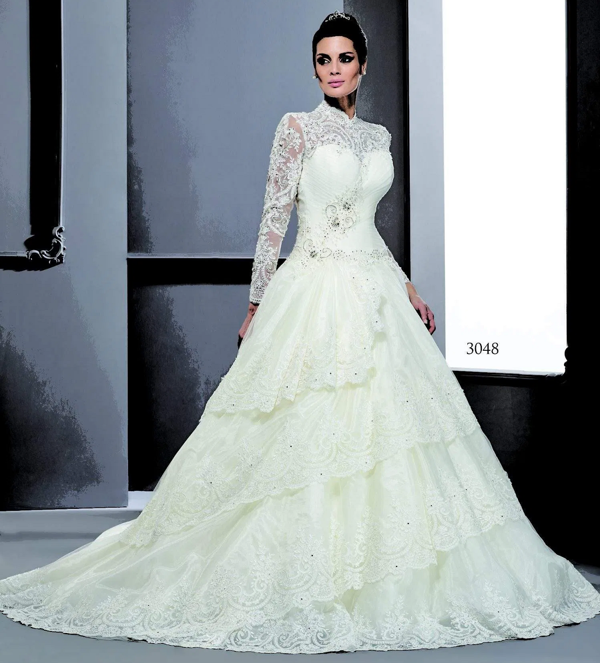 Wedding dress bling Long Sleeve Bridal Dresses in Lace Fabric Adorned with Crystals and Other beads On The Bodice