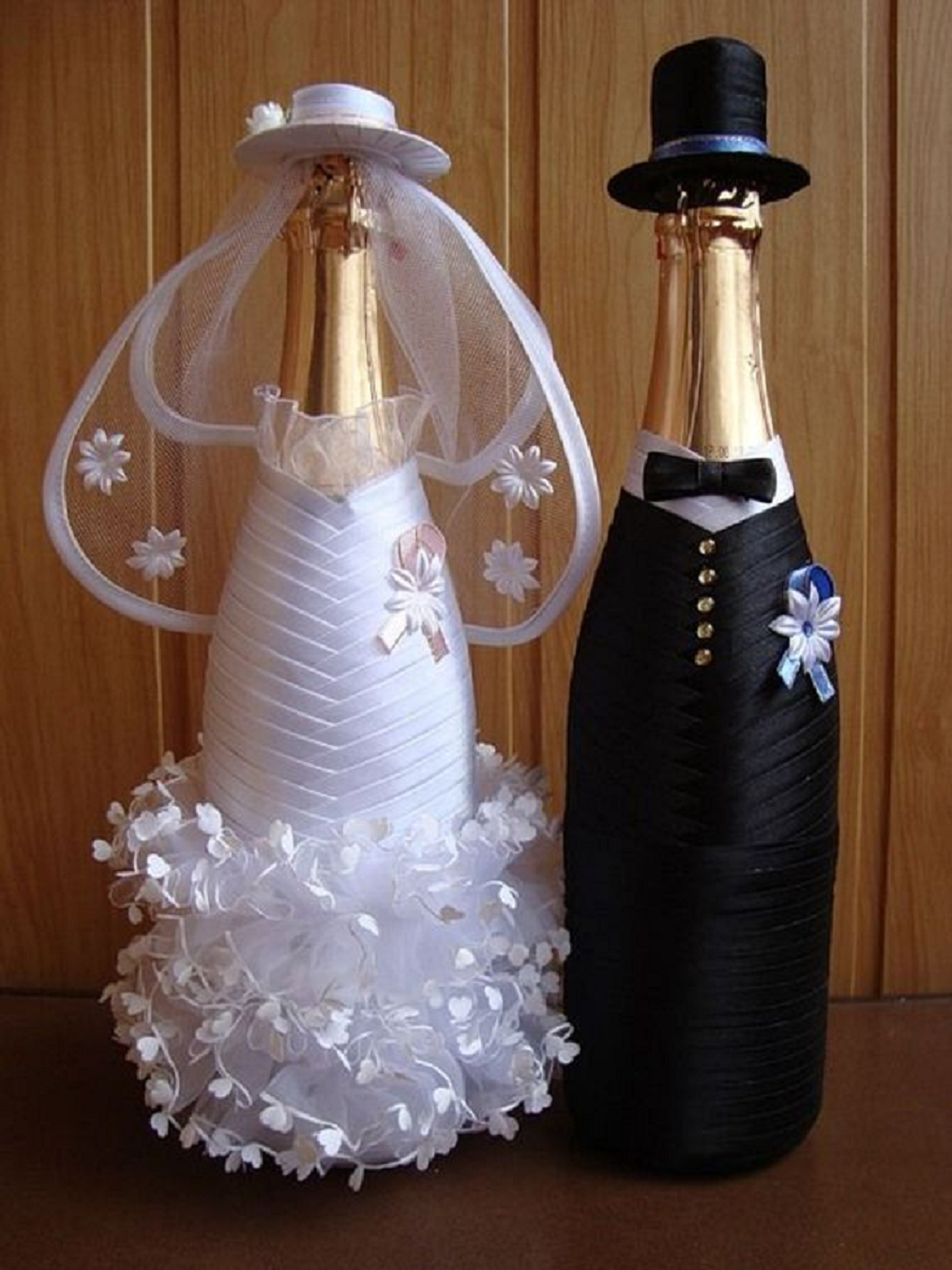 Bling wedding receptions Glittering Bride and Groom Decorated Champagne Bottles