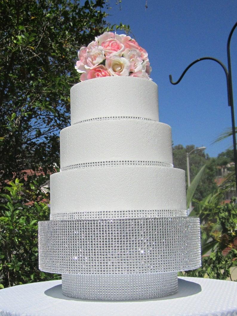 Bling wedding accessories White Round Wedding Cake with Sparkling Diamond Bling Rhinestones and A Glittering Cake Raiser