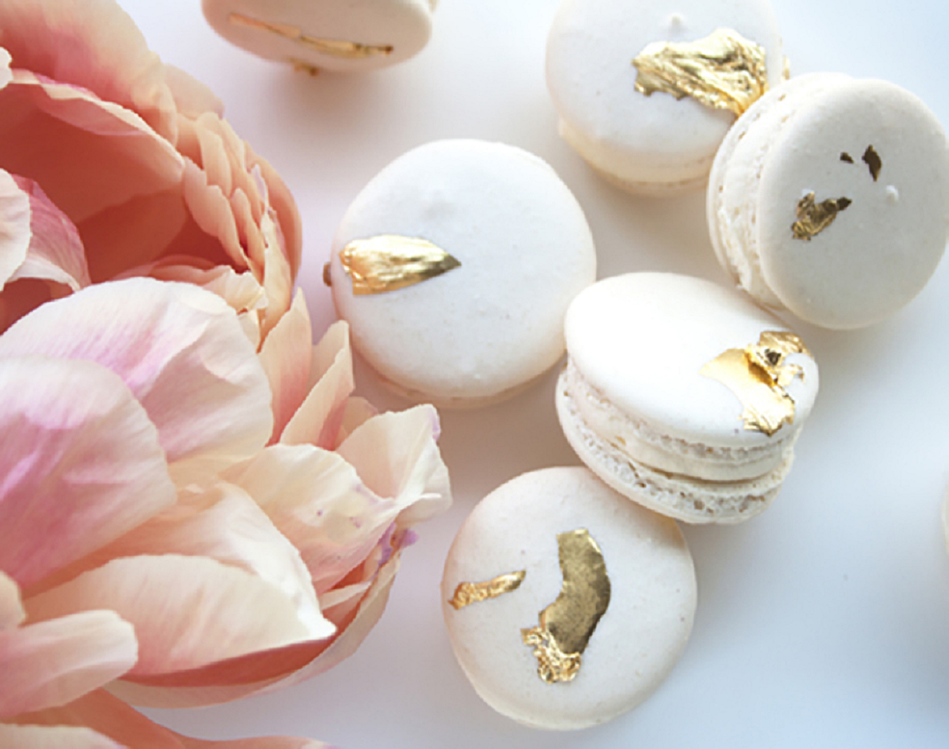 Bling wedding receptions Everyone Loves These Gold Flecked Macarons. Try Stacking Them For a Quirky Cake