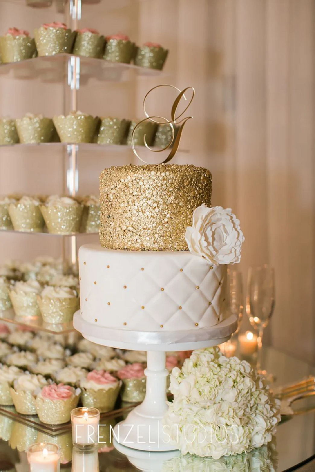 Bling wedding receptions Good Decision To Have a Gold Glittering Wedding Cake Surrounded By Pretty Cupcakes!