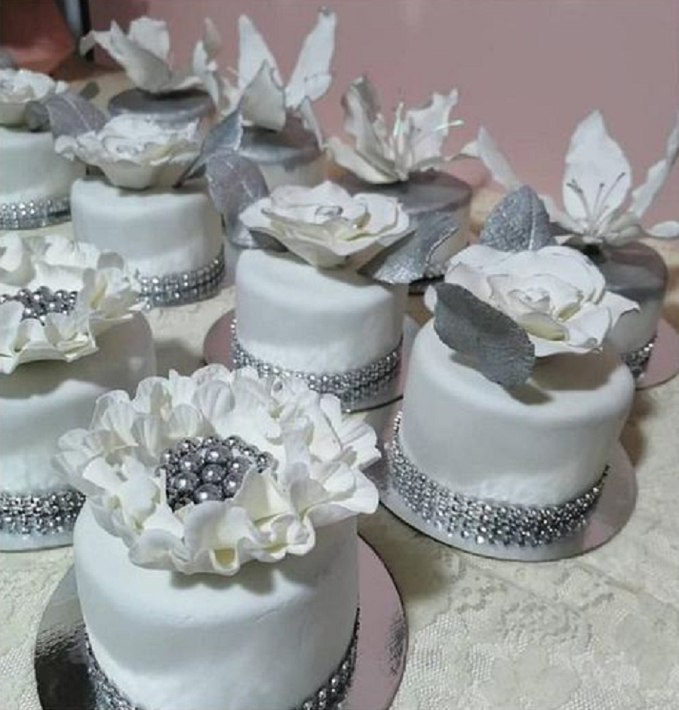 Bling wedding receptions Wedding Cake In White with A Floral Design and Rhinestone Trims