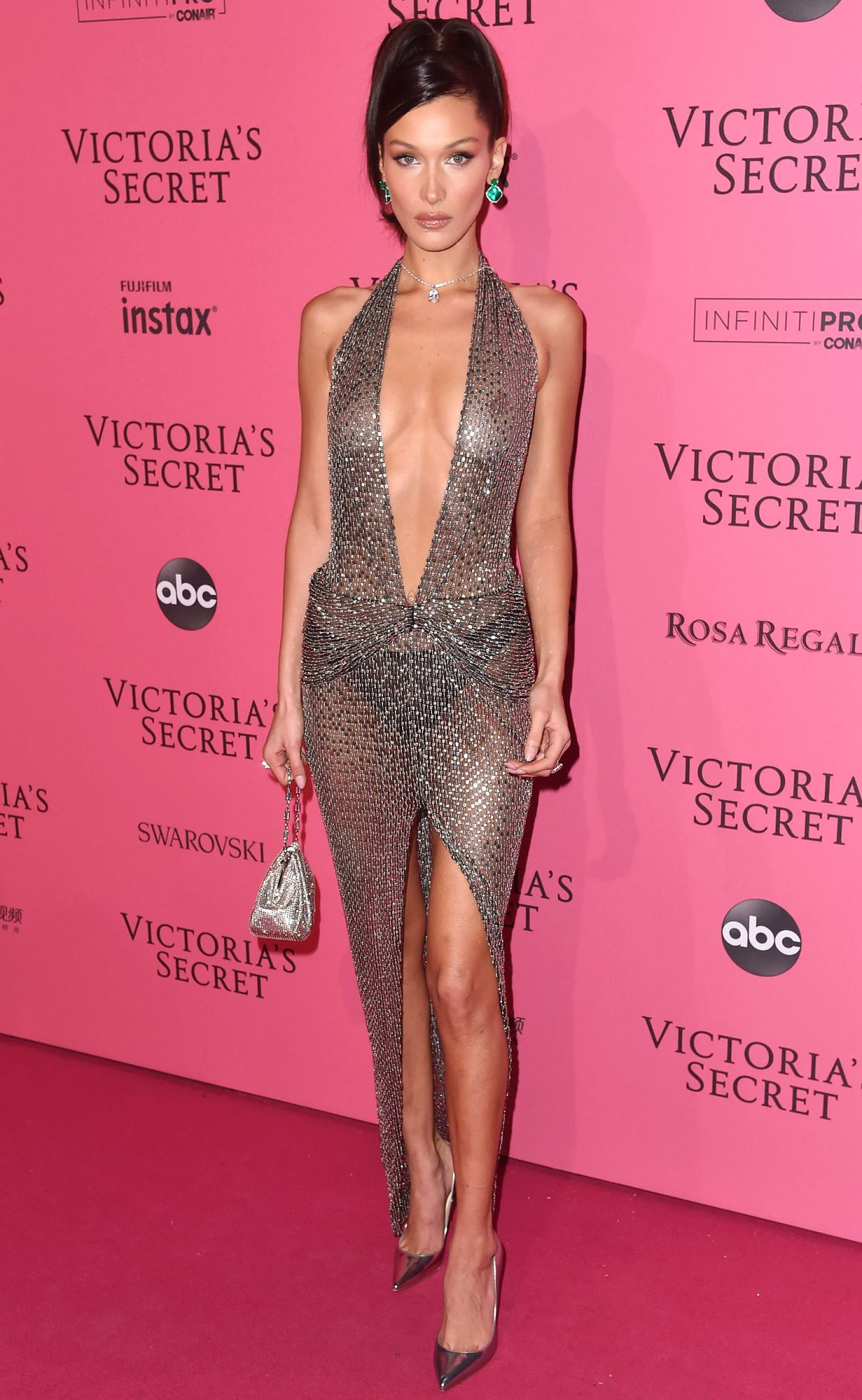 Red Carpet bling Bella Hadid Wears A Silver See Through Long Gown with Deep Plunging Neckline and High Slit