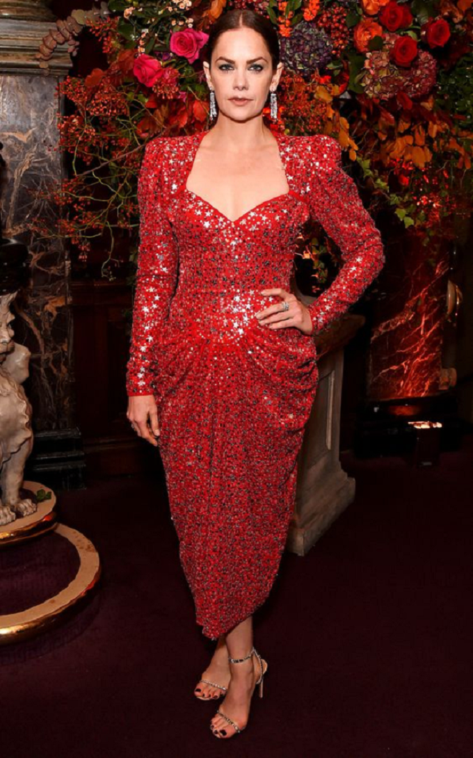 Celebrities Wearing Bling Ruth Wilson Wearing A Red and Silver Star Printed Sequin Dress with Long Sleeves and High Heel Sandals