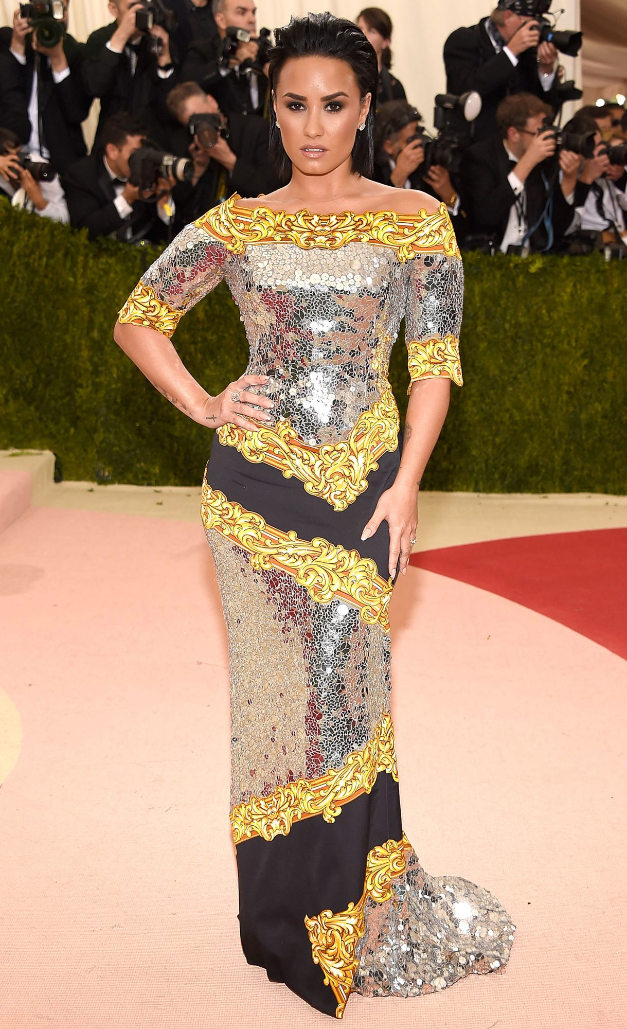 Celebrities Wearing Bling Demi Lovato Wears Her Long Black Gold and Silver Sequin Gown with a Sequin Train