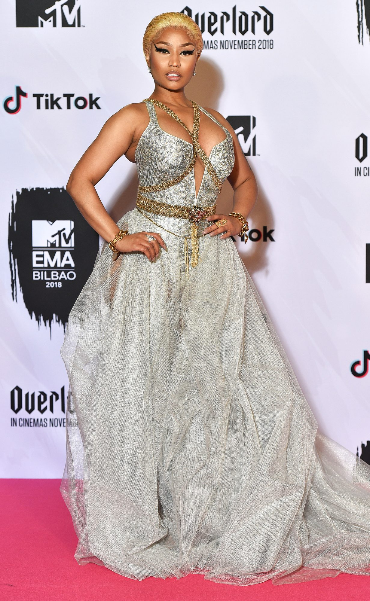 Red Carpet bling Nicki Minaj In A Glittering Silver Gown with A Corset Bodice with A Deep V-Neck